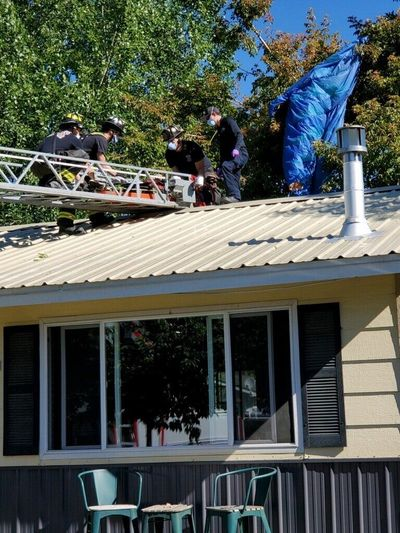 A skydiver was hospitalized and expected to make a full recovery after crash-landing onto the roof of a home near Sandpoint on Sunday.  (Bonner County EMS)