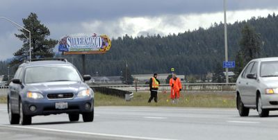 Washington State Patrol investigators examine the scene Thursday. (Jesse Tinsley / The Spokesman-Review)