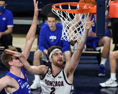 Gonzaga's Drew Timme fends off the defense of BYU's Matt Haarms in the first half of a Jan. 7 game in the McCarthey Athletic Center.  (By Colin Mulvany / The Spokesman-Review)