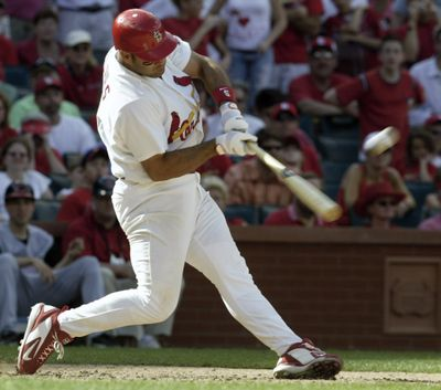St. Louis Cardinals' Albert Pujols connects for a game-winning two-run home run in the ninth inning against the Cincinnati Reds in a baseball game Sunday, April 16, 2006, at Busch Stadium in St. Louis. Pujols hit three home runs as the Cardinals beat the Reds 8-7.  (Associated Press)