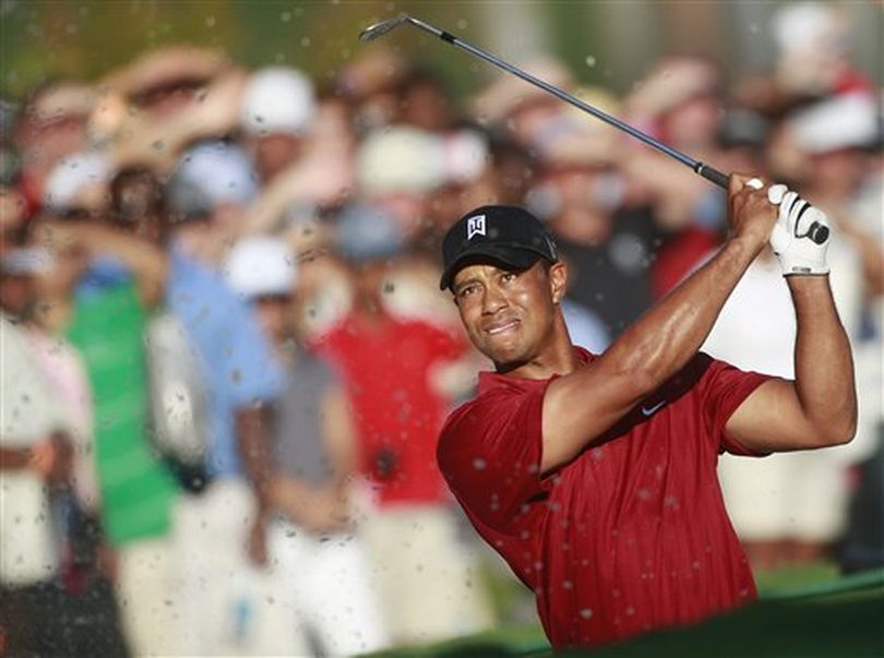 Tiger Woods hits from the sand on the 18th hole during the final round of The Tour Championship golf tournament at East Lake Golf Club in Atlanta Sunday, Sept. 27, 2009. Woods finished another big year by winning the FedEx Cup and its $10 million bonus.  (Dave Martin / AP Photo)