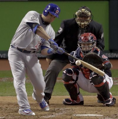 Chicago Cubs' Kyle Schwarber hits a double against the Cleveland Indians during the fourth inning of Game 1 of the World Series. (Charlie Riedel / Associated Press)