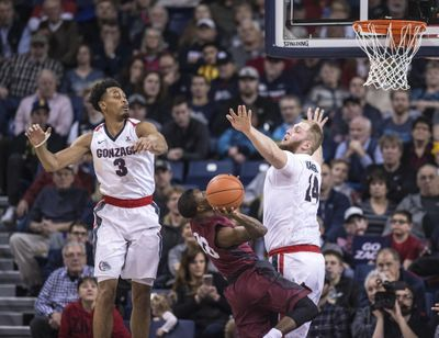 Gonzaga center Przemek Karnowski and Johnathan Williams, left, pressure LMU guard Brandon Brown, Jan. 12, 2107, in the McCarthey Athletic Center. (Dan Pelle / The Spokesman-Review)