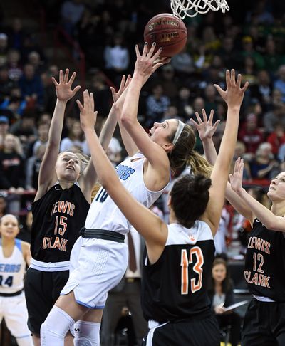 Lewis and Clark guard Andie Zylak (15) and teammate Jacinta Buckley (13) defend Central Valley's Lexie Hull during the 2018 District 8 4A girls basketball title game at the Arena.  (COLIN MULVANY)