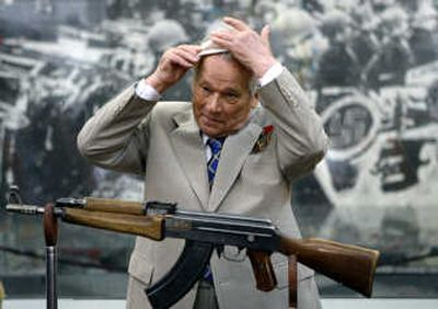 Mikhail Kalashnikov, 87, stands beside his AK-47 Nr.1, a prototype of the AK-47, during a ceremony Friday in Moscow. Associated Press  (Associated Press / The Spokesman-Review)
