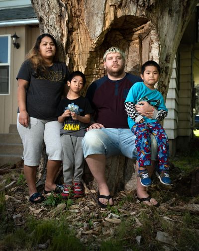James Hook's wife Emako Loran, on left, lost her job at the Davenport as a housekeeper. He has not been working because his two children, Edward Domingo, 5, on left, and Enzo Domingo,4, have extreme medical issues and he was navigating all of their appointments. They have been dealing with housing insecurity, and have been unable to obtain unemployment assistance. (Colin Mulvany / The Spokesman-Review)