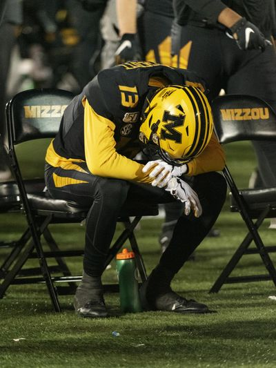 Missouri wide receiver Kam Scott sits alone on the bench in the final seconds of their 24-20 loss to Tennessee on Saturday in Columbia, Mo. (L.G. Patterson / Associated Press)