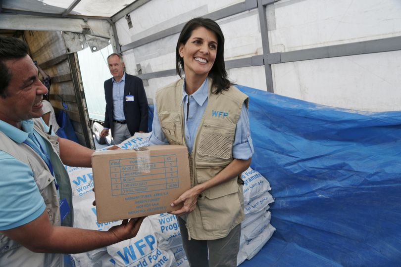 In this May 24 photo, U.S. Ambassador to the U.N. Nikki Haley holds a food parcel provided by the World Food Programme, part of the humanitarian aid shipments into Syria, during a visit at the Reyhanli border crossing with Syria, near Hatay, southern Turkey. Haley is presenting another side of President Donald Trump's America First doctrine, one that focuses on human rights and humanitarian assistance. (Burhan Ozbilici / Associated Press)