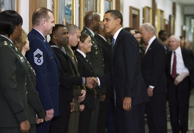 President Barack Obama, Vice President Joe Biden  and Secretary of Defense Robert Gates greet members of the U.S. armed forces during a visit to the Pentagon on Wednesday.  (Associated Press / The Spokesman-Review)