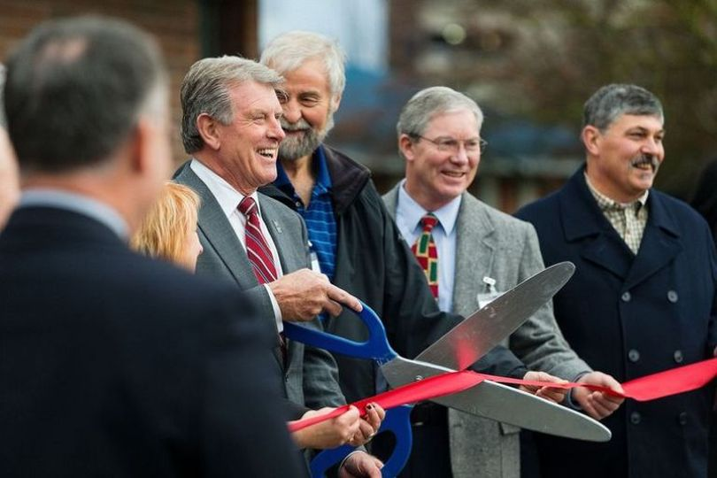 Gov. Butch Otter jokingly begins a countdown at 99 during a ribbon-cutting for the Northern Idaho Crisis Center on Tuesday in Coeur d'Alene. (Shawn Gust / Coeur d'Alene Press)