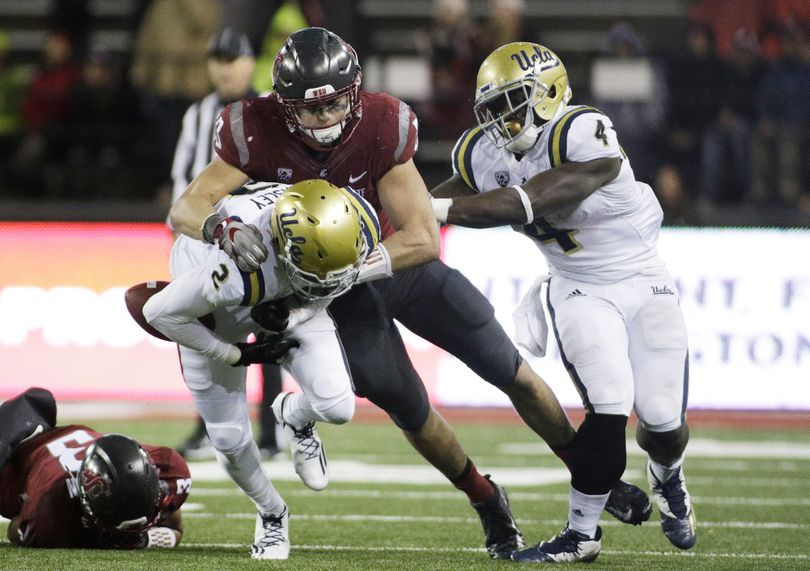 Washington State linebacker Dylan Hanser forces a fumble during the second half of an NCAA college football game in Pullman, Wash., Saturday, Oct. 15, 2016. (Young Kwak / AP)