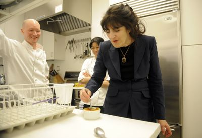 Associated Press Gourmet magazine editor Ruth Reichl, right, tastes an avocado crème brulee created by chefs Ian Knauer, left, and Kay Chun, in the magazine's kitchen in New York last month. (Associated Press / The Spokesman-Review)
