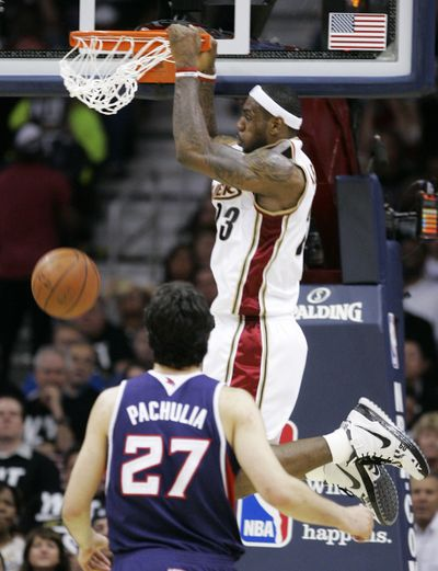 Cleveland's LeBron James slams home two of his 34 points Tuesday.  (Associated Press / The Spokesman-Review)