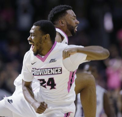 Providence guard Jalen Lindsey, rear, celebrates with guard Kyron Cartwright (24) during the second half of the team's NCAA college basketball game against Villanova on Wednesday, Feb. 14, 2018, in Providence, R.I. Providence upset No. 3 Villanova, 76-71. (Stephan Savoia / Associated Press)