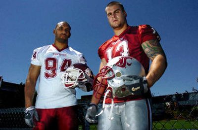 Washington State University defensive ends Mkristo Bruce, left, and Adam Braidwood may have a future as film critics.   (Kevin Nibur/ / The Spokesman-Review)