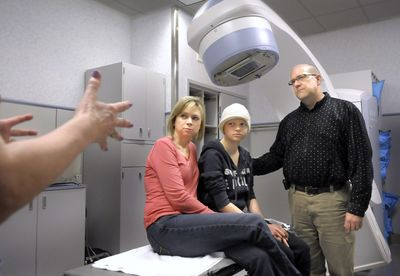 Tami, Hannah and Mike Baumann listen to registered nurse Marcy Kelly in the radiology department at Sacred Heart  Medical Center on Friday. An aspiring dancer, Hannah put off her cancer treatment until after she could perform with the Moscow Ballet.  (CHRISTOPHER ANDERSON / The Spokesman-Review)