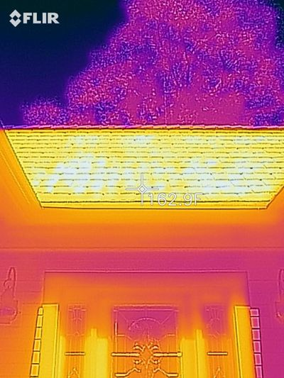 It's no wonder your attic is blistering hot. This is an infrared photo image of my roof. Its temperature exceeds 162 F, and that heat radiates into my attic and then into my home. (Tim Carter)