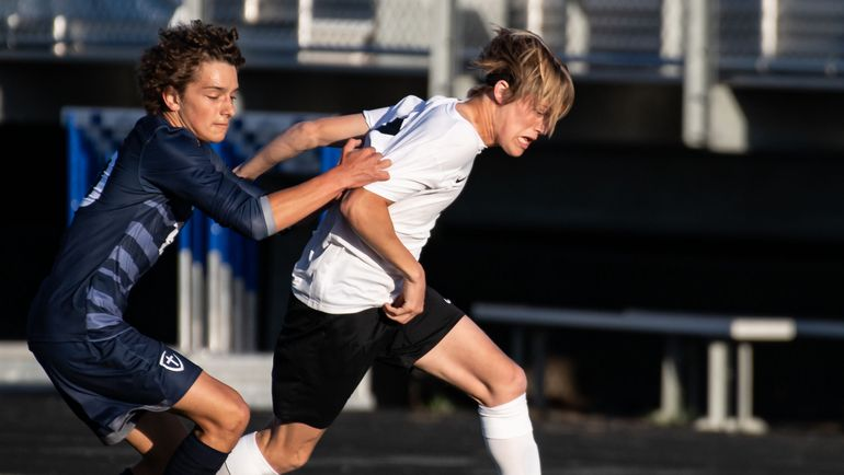Lewis and Clark's Dane Cobb moves the ball downfield as Gonzaga Prep's Andre Layman gives chase during Wednesday's 4A Greater Spokane League soccer match at Gonzaga Prep.  (Colin Mulvany/The Spokesman-Review)