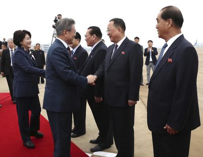 South Korean President Moon Jae-in, second from left, and  wife Kim Jung-sook are greeted by North Korean officials as they leave for the Mount Paektu, at Sunan International Airport in Pyongyang, North Korea, Thursday, Sept. 20, 2018. (Pyongyang Press Corps Pool)