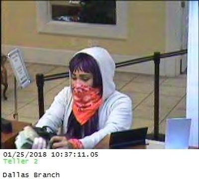 This security camera image released by the FBI shows a 25-year-old woman dubbed the