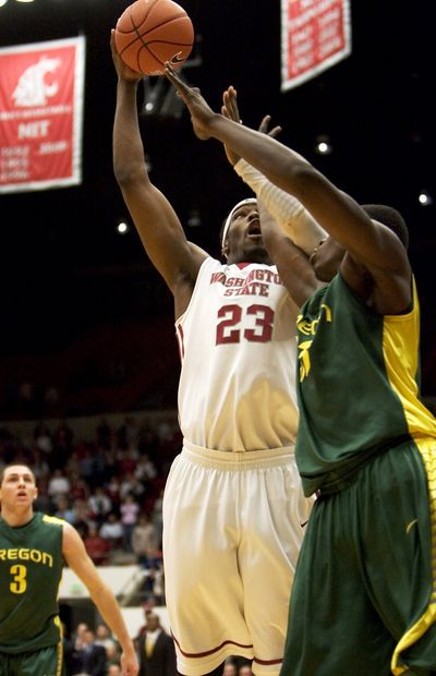 WSU thought it had defeated Oregon on this DeAngelo Casto basket Thursday in the first OT, but wound up losing in two OTs.  (Associated Press)