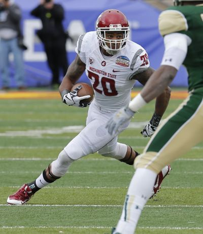 Washington State safety Deone Bucannon runs back an interception against Colorado State in 2013 New Mexico Bowl. (Associated Press)