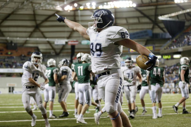 Gonzaga Prep's Evan Weaver  celebrates after scoring a touchdown against Skyline during the second half of the State 4A football championship game in Tacoma.