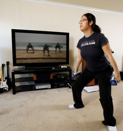 Trina Schwimmer uses workouts downloaded from Netflix instead of DVD's of old for her daily aerobics exercises at her apartment in Marina Del Rey, Calif.  (Associated Press / The Spokesman-Review)