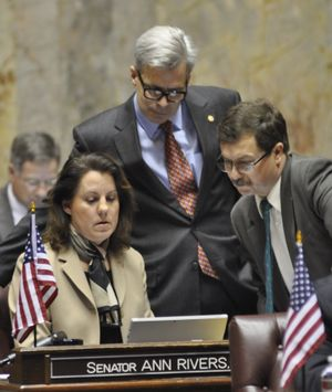 OLYMPIA -- Sens. Mark Schoesler, right, Steve Litzow and Ann Rivers monitor the vote count on an amendment to the medical marijuana bill Rivers sponsored. (Jim Camden)