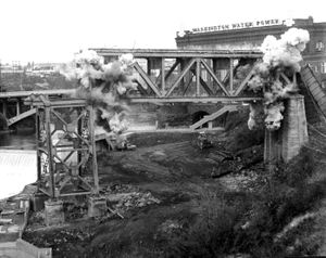 In 1973 the last section of the Union Pacific Railroad trestle was destroyed by explosives.  The trestle, which spanned the Spokane River and Monroe Street, was removed as part of the transformation of what is now Riverfront Park, to make way for Expo 74.     (Photo Archive)