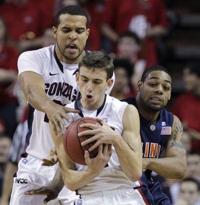 Gonzaga's David Stockton grabs a loose ball in front of teammate Elias Harris.  (Associated Press)