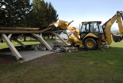 """Steve Spady of Skyline Construction knocks down the picnic shelter at Valley Mission Park on April 13. """"I wish they took this long to build,"""" he commented about the quick, 20-second demolition. The park is getting a new 2,400-square-foot shelter as part of a $156,173 project that includes new playground equipment, landscaping and lighting. The improvements are scheduled to completed by the end of May.  (J. BART RAYNIAK / The Spokesman-Review)"""