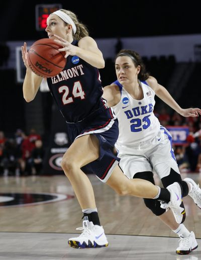 Belmont guard Jenny Roy (24) drives the ball down the court past Duke forward/center Jade Williams (25) during a first-round game in the NCAA women's college basketball tournament in Athens, Ga., Saturday, March. 17, 2018. (Joshua L. Jones / Associated Press)