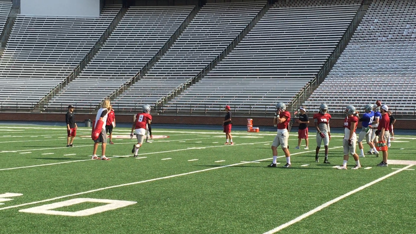 (The Washington State Cougars practice in Martin Stadium for the first time this season.)