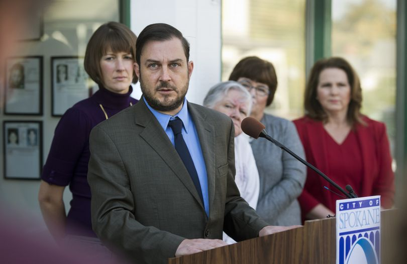 """Spokane City Council President Ben Stuckart tells the media Friday at C.O.P.S. West that """"I can't in good conscience vote for Mayor Condon's proposed 2015 budget."""" Behind him are council member Amber Waldref, Chief Garry Park neighborhood co-chair Colleen Gardner and council members Karen Stratton and Candace Mumm. """"I can comfortably say ... this budget for a vote today wouldn't get a single vote,"""" Stuckart said. (Dan Pelle)"""