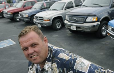Jon Burke of 3 Fat Guys on east Sprague in Spokane Valley has many SUVs and trucks waiting for sale on his lot.  (Dan Pelle / The Spokesman-Review)