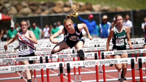 Chewelah's Lillian Kirry, center, clears a hurdle before winning the State 1A 100-meter hurdles during the 2018  track and field championship at Eastern Washington University. (Kathy Plonka / The Spokesman-Review)