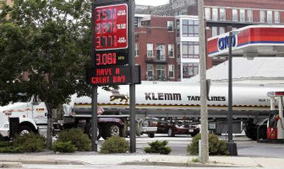 A tanker fills the tanks at a gas station Wednesday in Milwaukee. The potential damage to oil platforms, refineries and pipelines that remain closed along the Gulf Coast drove energy prices to new highs.   (Associated Press / The Spokesman-Review)