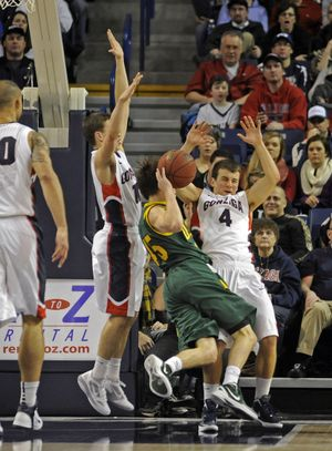 David Stockton, left, and Kevin Pangos, rear, of Gonzaga combine to stop the drive of Cody Doolin of San Francisco and cause a turnover. (Christopher Anderson)