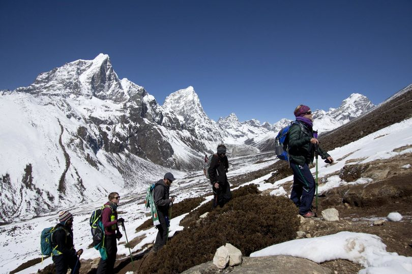 In this March 18, 2015 file photo, trekkers take an acclimatization hike to Nagarzhang peak above Dingboche valley on the way to Everest base camp, Nepal. Mohan Sapkota, a spokesman for the Himalayan country's ministry of tourism said Tuesday, Sept. 29, 2015, that Nepal is considering placing age and fitness limits for people who want to climb Mount Everest.  (Tashi Sherpa / Associated Press)