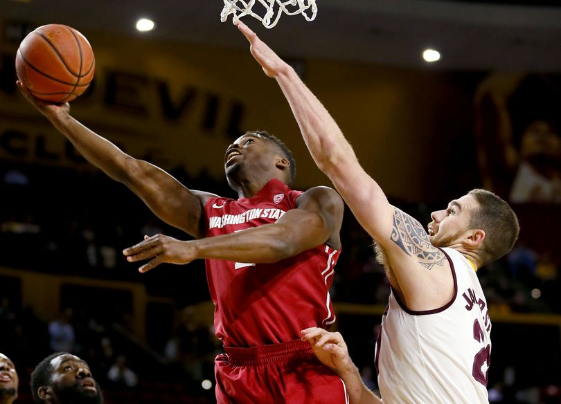 Washington State guard Ike Iroegbu, left, shoots as Arizona State forward Eric Jacobsen (21) defends during the first half of an NCAA college basketball game Thursday, Jan. 14, 2016, in Tempe, Ariz. (Matt York / AP)