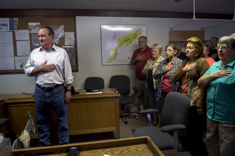 Idaho Senator Mike Crapo says The Pledge of Allegiance before holding a town hall meeting at Wardner City Hall on Thursday, September 1, 2016. (Kathy Plonka / The Spokesman-Review)
