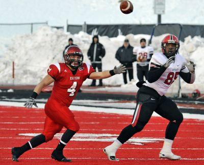EWU's J.C. Sherritt, left, closed in on the ball and Southeast Missouri's Bradley Brown last Saturday. (Dan Pelle)