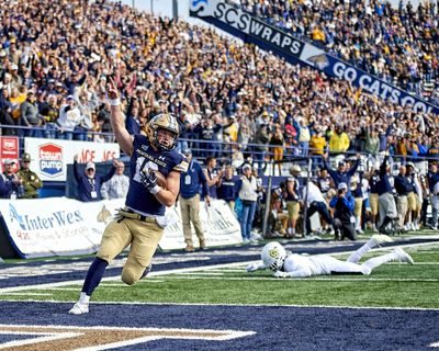 Montana State quarterback Tommy Mellott celebrates a touchdown during the first half of the Bobcats' game against Cal Poly on Saturday in Bozeman, Montana  (Kelly Gorham)