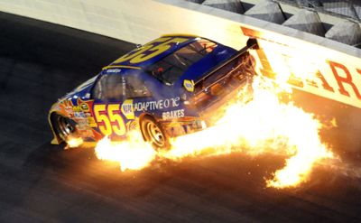 Michael Waltrip's car catches fire as his engine blows during the Southern 500 in Darlington, S.C. (Associated Press / The Spokesman-Review)