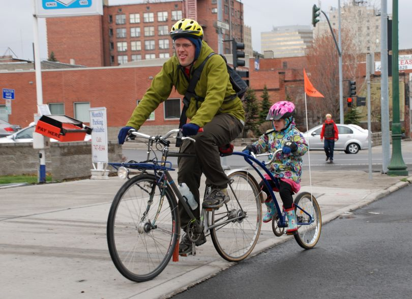 Jon Snyder, pictured biking his daughter to school in 2009, is a supporter of bicycle transportation and recreation.  (Rich Landers / The Spokesman-Review)