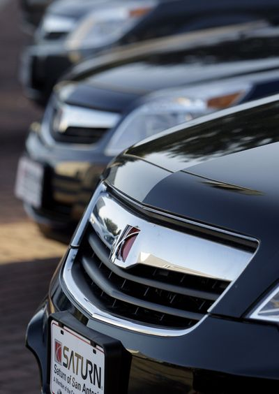 Saturn automobiles sit at a lot in San Antonio. General Motors Co. is giving dealers financial incentives to move Saturns and Pontiacs off their lots. The brands are being discontinued and GM wants dealers to get rid of their leftover inventories.  (FILE Associated Press)