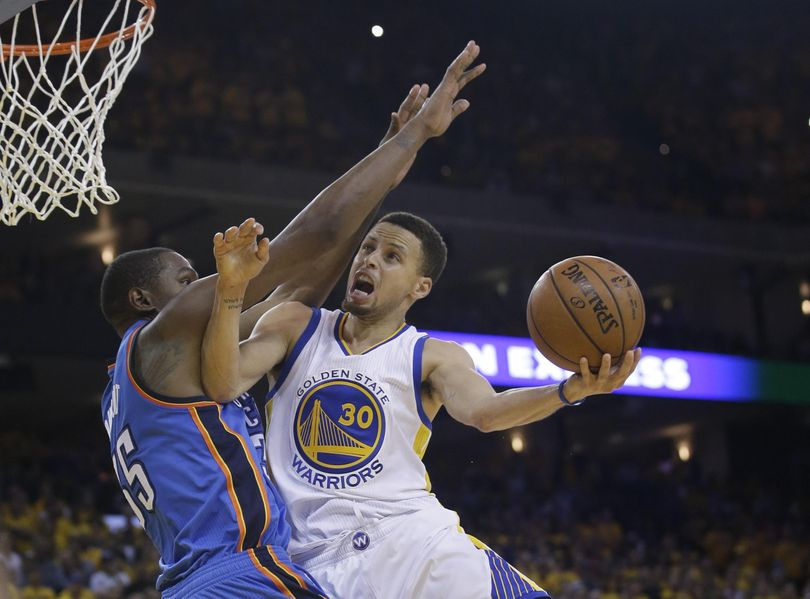 Warriors' Stephen Curry won't have to try and score over Kevin Durant next season. (Marcio Jose Sanchez / Associated Press)