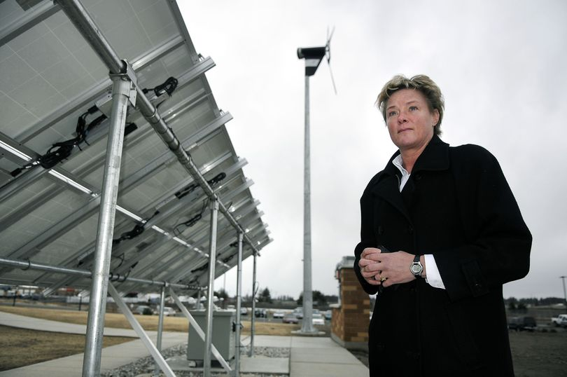 Demand Energy Networks, for which Randi Neilson is a vice president, has developed a battery-based system for storing electricity. This demonstration project at Inland Power and Light includes wind-generated and solar power feeding into the battery container beneath the solar panel.danp@spokesman.com (Dan Pelle / The Spokesman-Review)