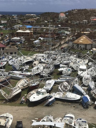 This Sept. 14, 2017, photo  shows some damaged boats at the Virgin Gorda Yacht Harbour in the aftermath of Hurricane Irma on Virgin Gorda, in the British Virgin Islands. (Guillermo Houwer / Associated Press)